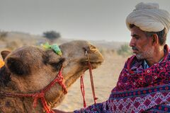 An Indian cameleer with his camel