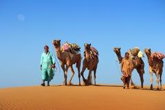 Cameleers in desert Royalty Free Stock Photos