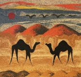 Camels in desert. Textured illustration of two silhouetted camels in sandy desert with dunes in background Royalty Free Stock Image