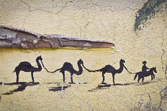 Camels - ships of the desert. Wall picture of a camel caravan Royalty Free Stock Photo