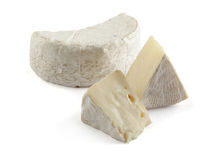 Camembert. Some pieces of camembert on the white stock photography