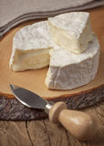 Camembert. Creamy soft camembert cheese on wooden board Royalty Free Stock Photo