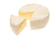 Camembert. Cheese with a cut wedge isolated on white royalty free stock photos