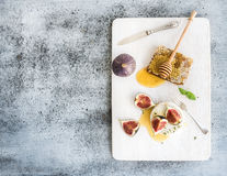 Camembert or brie cheese with fresh figs Stock Image