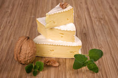 Camembert cheese. Delicious camembert cheese with nut and fresh green herb arranged on wooden board royalty free stock images