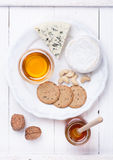 Camembert cheese and blue cheese with honey and nuts Stock Images