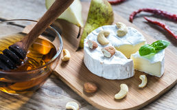 Camembert cheese. With cashew on the wooden board Royalty Free Stock Photography