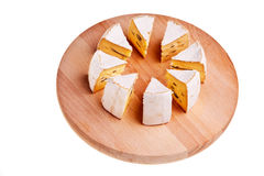 Camembert cheese cut into radial sections. Stock Images