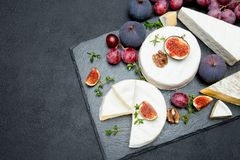 Camembert cheese and cut a slice on stone serving board Royalty Free Stock Image