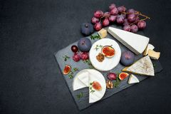 Camembert cheese and cut a slice on stone serving board Royalty Free Stock Images