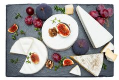 Camembert cheese and cut a slice on stone serving board Royalty Free Stock Photography