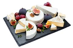 Camembert cheese and cut a slice on stone serving board Royalty Free Stock Photos
