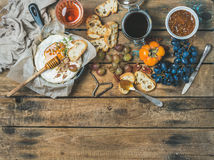 Camembert cheese, fruits, bread, honey, nuts, jam and rose wine Royalty Free Stock Images
