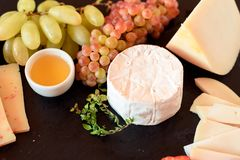 Camembert cheese with fruits stock image