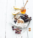 Camembert cheese with grape, walnuts, pear and Stock Image