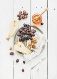Camembert cheese with grape, walnuts, pear and Stock Photography
