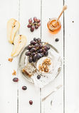 Camembert cheese with grape, walnuts, pear and Stock Photo