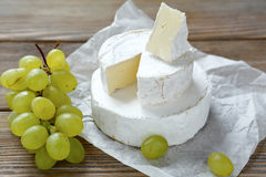 Camembert cheese with grapes Royalty Free Stock Images