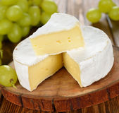 Camembert cheese with grapes Royalty Free Stock Photos