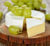 Camembert cheese with grapes Royalty Free Stock Photography