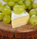 Camembert cheese with grapes Royalty Free Stock Photo