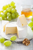 Camembert cheese grapes, honey nuts Stock Photography