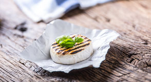 Camembert cheese. Grilled camembert cheese with olive oil and basil leaves.  Royalty Free Stock Images