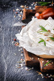 Camembert cheese with herbs Royalty Free Stock Photo