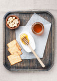 Camembert cheese with honey, nuts and cookies Royalty Free Stock Photo