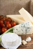 Camembert Cheese In Front Of Danish Blue And Eidam Stock Photos