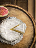 Camembert cheese on old wooden board Royalty Free Stock Photography