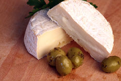 Camembert cheese and olives Royalty Free Stock Image