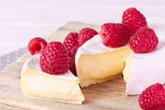 Camembert cheese with raspberry Royalty Free Stock Photos