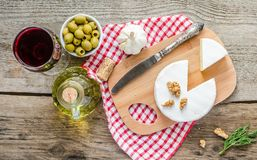 Camembert cheese and red wine Royalty Free Stock Photos
