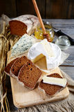 Camembert cheese, rye Bread slices, roquefort and honey Stock Photos