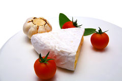 Camembert cheese with tomato and garlic Royalty Free Stock Image