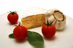 Camembert cheese and vegetables on white dish Royalty Free Stock Photo
