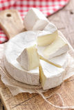 Camembert. Cheese on a vintage wood Royalty Free Stock Image