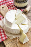 Camembert. Cheese on a vintage wood Royalty Free Stock Photography