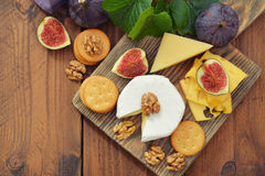 Camembert cheese with walnuts and figs Stock Images