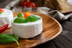 Camembert cheese with whole wheat bread and basil Stock Photo
