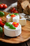 Camembert cheese with whole wheat bread and basil Royalty Free Stock Images