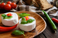 Camembert cheese with whole wheat bread and basil Royalty Free Stock Image