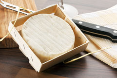 Camembert cheese in wooden crate Royalty Free Stock Images