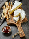 Camembert cheese on wooden cutting board Stock Image