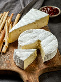 Camembert cheese on wooden cutting board Royalty Free Stock Image