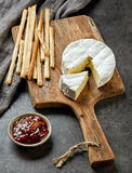 Camembert cheese on wooden cutting board Royalty Free Stock Images
