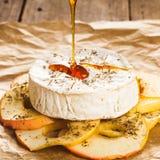 Camembert cotto Fotografie Stock