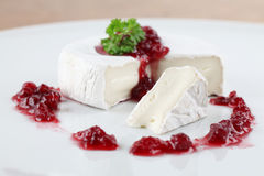 Camembert with cranberry jam Royalty Free Stock Image