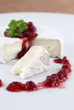Camembert with cranberry jam Royalty Free Stock Images